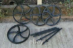A Set Of 4 Black Cast Iron Wheels With Axles Hen House Wheels Shepherds Hut